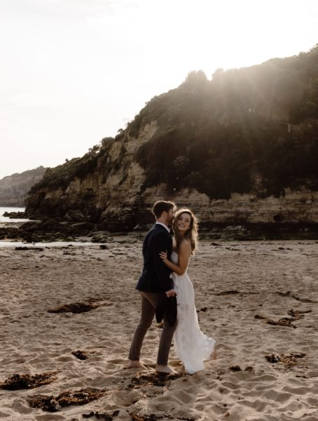 Couple kissing at wedding on Great Ocean Road