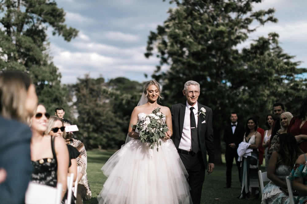 Father walking bride at Werribee Mansion
