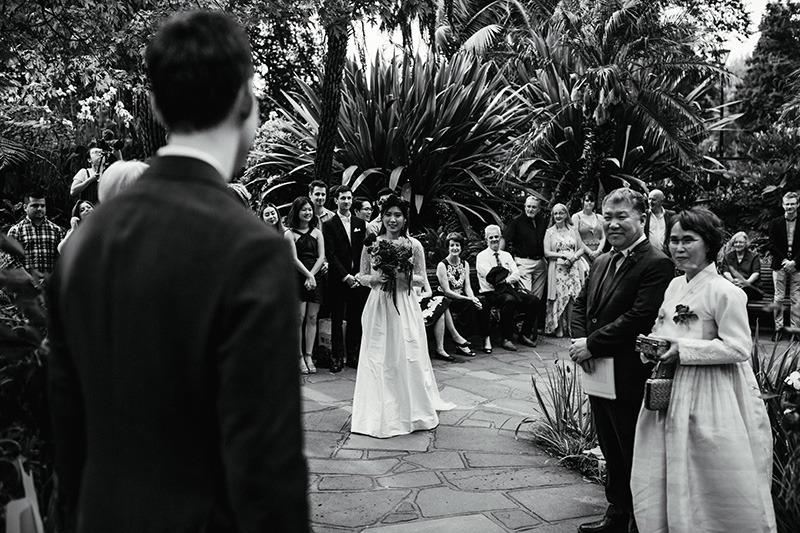 Bride on aisle Fitzroy Gardens