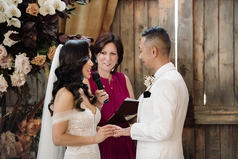 Couple exchanging rings on wedding day