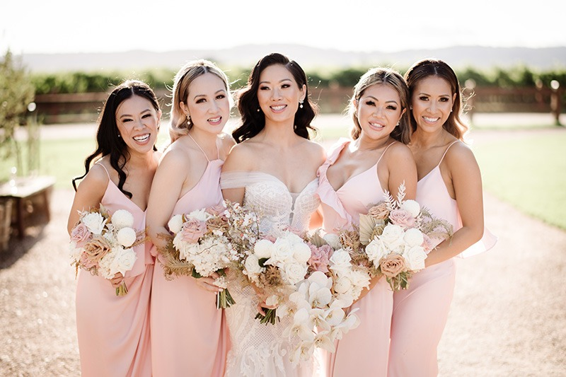 Bride and her wedding party on wedding day