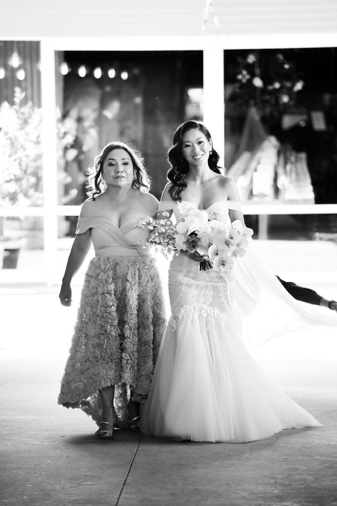Bride and her mother walking down the aisle