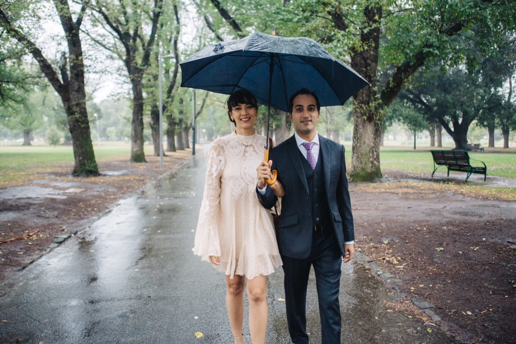 bride and groom in the rain in eloping in Victoria ceremony