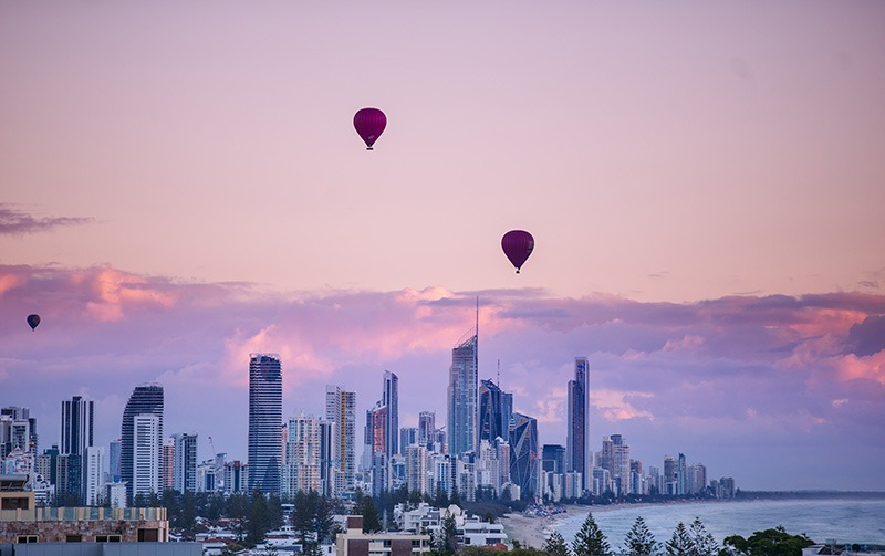 City landscape with hot air balloons