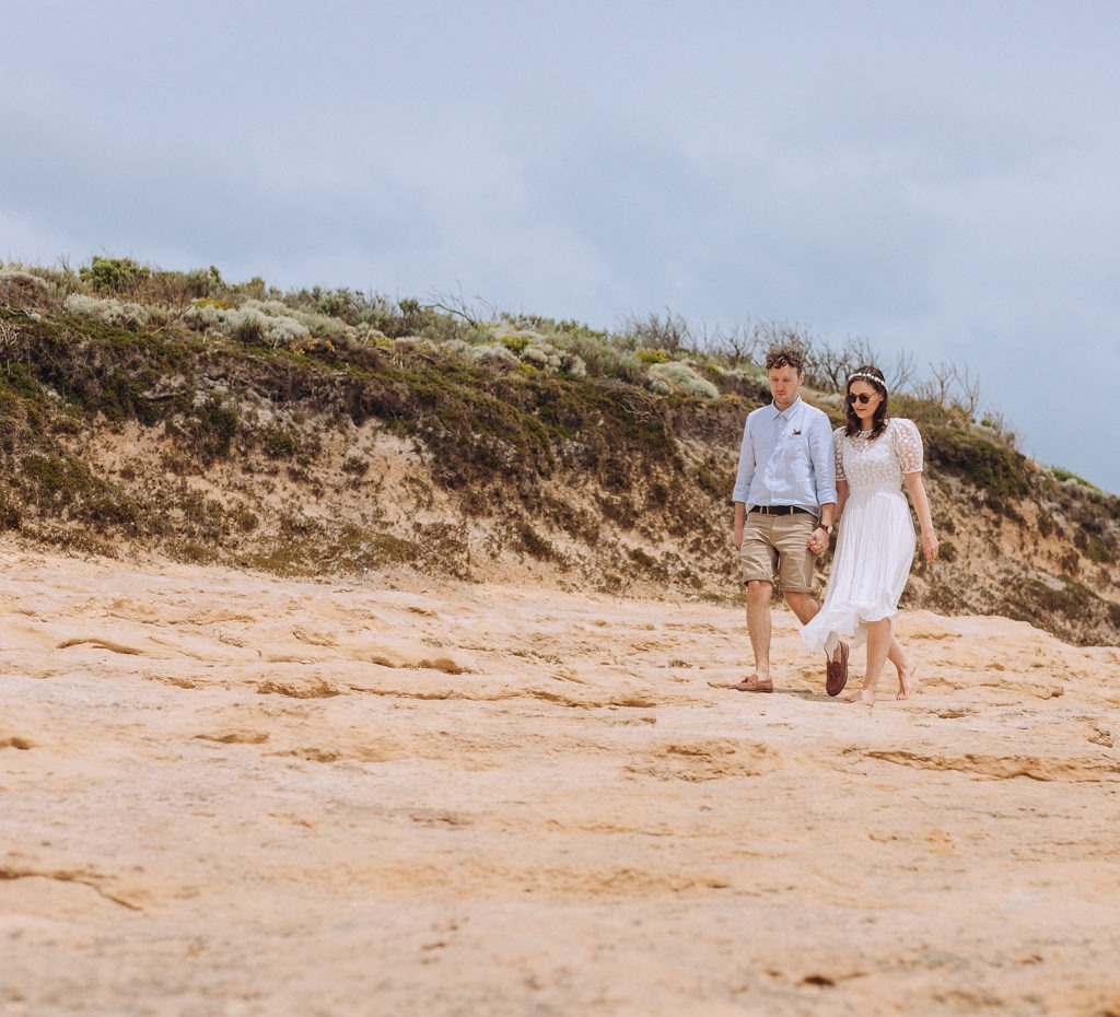 Couple on beach on Great Ocean Road