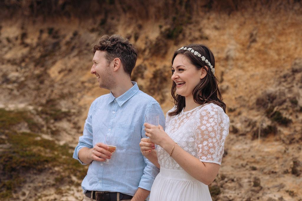 Couple enjoying champagne on wedding day