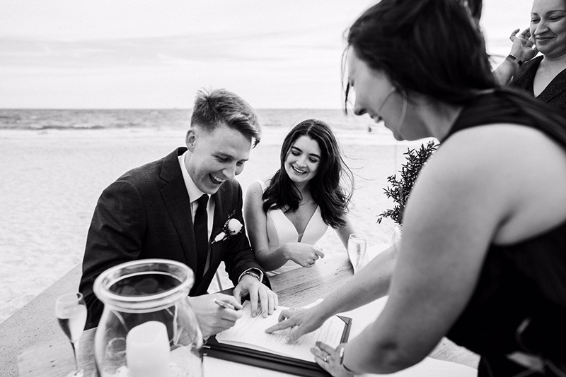 Couple signing certificates at wedding