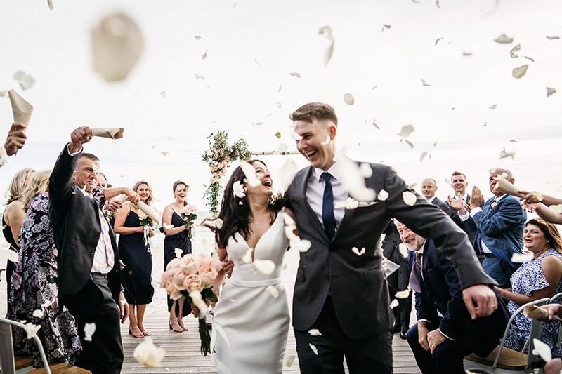 Couple on wedding day at Sandbar Beach Cafe