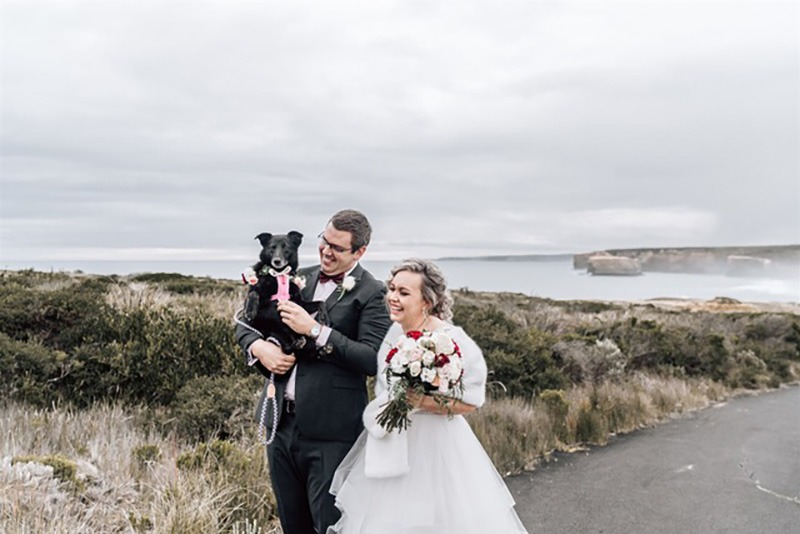 couple and dog on wedding day