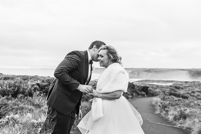Couple exchanging rings loch ard gorge elopement