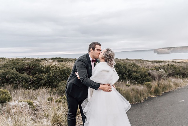 Couple kissing at Loch Ard Gorge Elopement