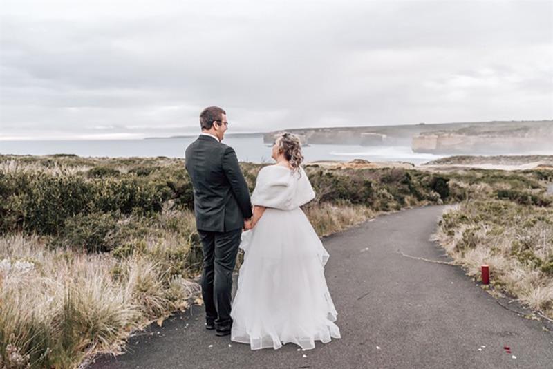 Couple look to ocean on Loch Ard Gorge wedding
