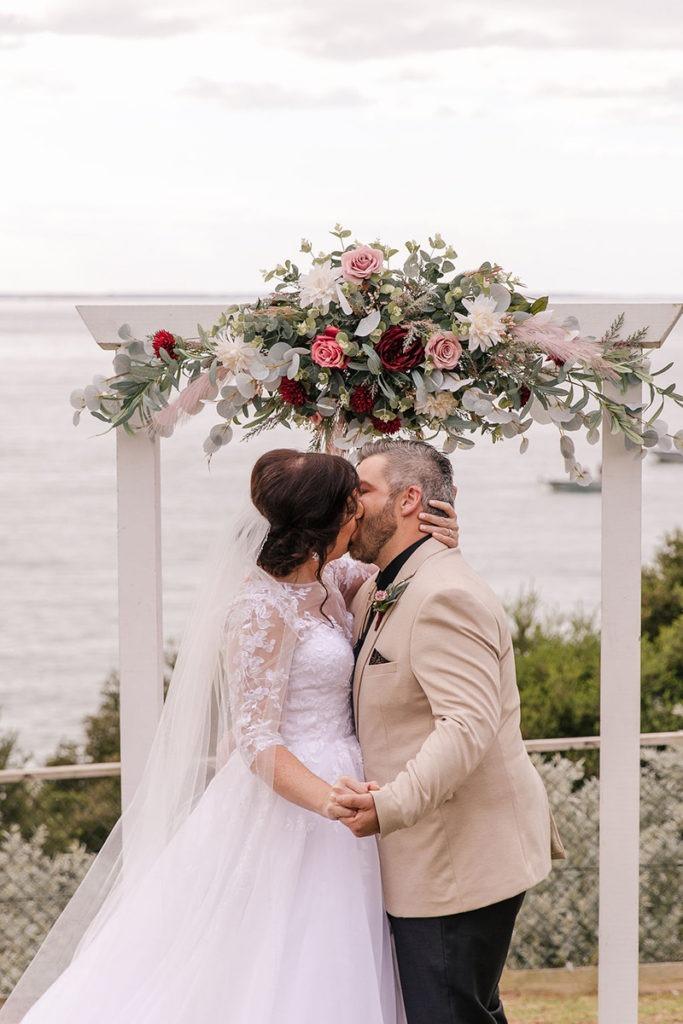 Couple kissing at Mornington Peninsula wedding