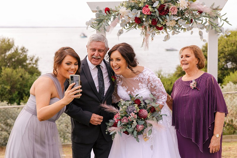 Family zoom call at Portsea Hotel wedding