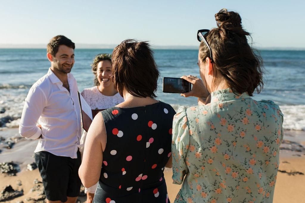 Couple on beach wedding with zoom
