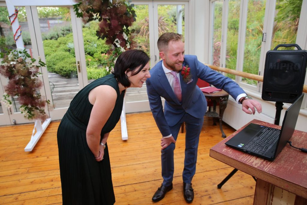 celebrant and groom welcome guests to zoom wedding
